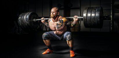 man weigh lifting