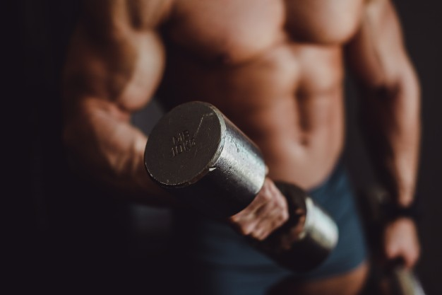 man in steroids for sale with dumb bell